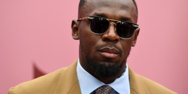 El atleta jamaicano Usain Bolt presenta a su hija, Olympia Lightning Bolt